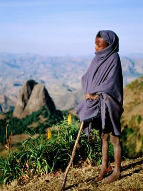 Shepherd Boy with Simien Mountains Background, Simien Mountains National Park, Ethiopia by Frances Linzee Gordon