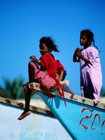 Young Girls on Dhow Fishing Boat Near Qalansia Village, Yemen by Frances Linzee Gordon