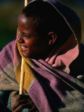 Young Shepherd Boy in Highlands, Early Morning, Simien Mountains National Park, Ethiopia by Frances Linzee Gordon
