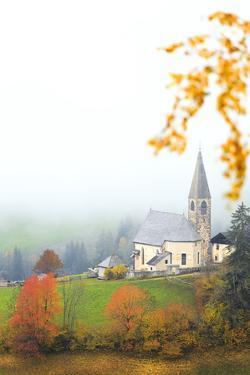 Church of Santa Magdalena in the autumn mist, Funes Valley, Sudtirol (South Tyrol), Dolomites, Ital by Francesco Bergamaschi