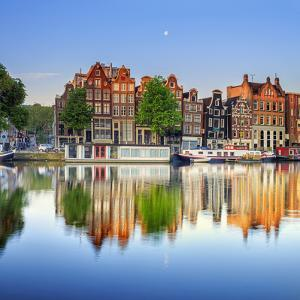Netherlands, North Holland, Amsterdam. Typical Houses and Houseboats on Amstel River by Francesco Iacobelli