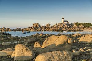 Boats and Pontusval lighthouse, Brignogan Plage, Finistere, Brittany, France, Europe by Francesco Vaninetti