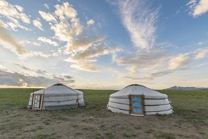 Mongolian nomadic traditional gers and clouds in the sky, Middle Gobi province, Mongolia, Central A by Francesco Vaninetti
