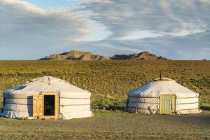 Two Mongolian nomadic gers and mountains in the background, Bayandalai district, South Gobi provinc by Francesco Vaninetti
