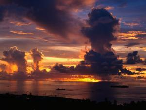 Sunset Over Harbor, Saipan by Francie Manning