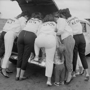 "All-Girl ""Dragettes"" Hotrod Club Working on Car Engine, Kansas City, Kansas, 1959 by Francis Miller"