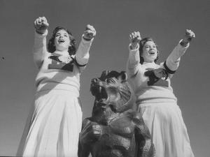 Coach of Lawrence High School Cheerleaders During Football Game by Francis Miller