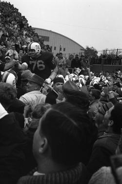 Spectators at the Minnesota- Iowa Game, Minneapolis, Minnesota, November 1960 by Francis Miller