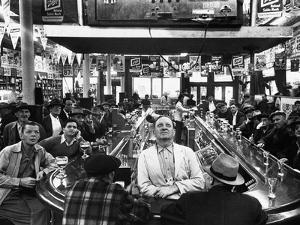 Subway Series: Rapt Audience in Bar Watching World Series Game from New York on TV by Francis Miller