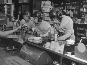 """Teammates """"Little Golds"""" Football Having Soda at Robertson's Drugstore by Francis Miller"""