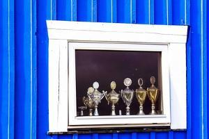 Window Display with Football Cups in a House of the Village Ilulissat, Greenland by Françoise Gaujour