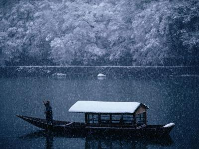 A Traditional Leisure Boat During a Snowfall at Arashiyama West of Kyoto, Kyoto, Kinki, Japan,