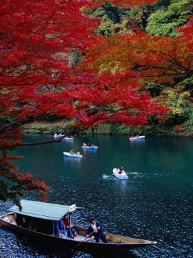 Boats with Tourists Showing Arashiyama's Autumn Colours, Kyoto, Japan by Frank Carter