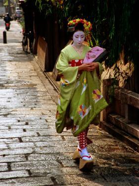 Maiko Walking Along Street in Gion, Kyoto, Japan by Frank Carter