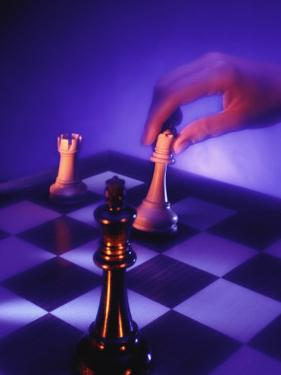 Hand Moving Chess Piece by Frank Cruz
