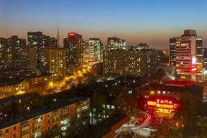 Elevated view of city near Beijing Zoo at dusk, Beijing by Frank Fell