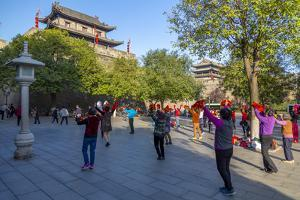 Locals performing Tai chi near City wall of Xi'an, Shaanxi Province by Frank Fell