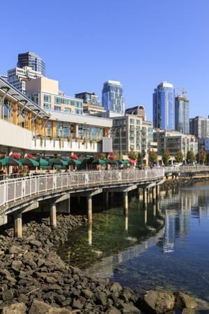 Seattle skyline and restaurants on sunny day in Bell Harbor Marina, Seattle, Washington State, Unit