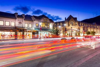 Trail lights and shops on Banff Avenue at dusk, Banff, Banff National Park, Alberta, Canada, North