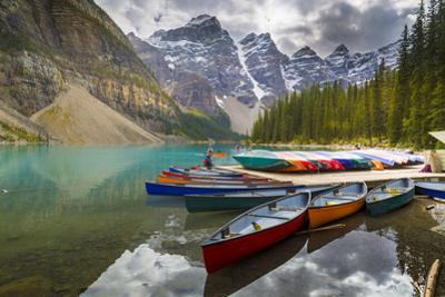 Tranquil setting of rowing boats on Moraine Lake, Banff National Park, UNESCO World Heritage Site,