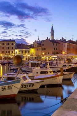 View of harbour and the old town with the Cathedral of St. Euphemia at dusk, Croatia by Frank Fell