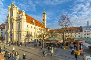 View of market and Heiliggeistkirche Church clock tower, Munich, Bavaria, Germany by Frank Fell