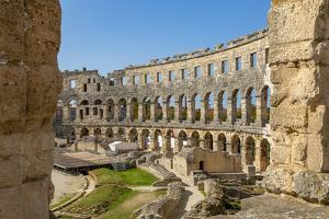 View of the Roman Amphitheatre against blue sky, Pula, Istria County, Croatia by Frank Fell