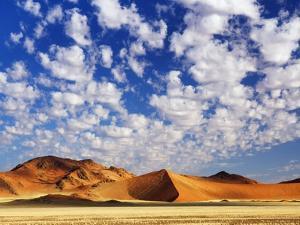 Dunes in Namib Desert Under White Clouds by Frank Krahmer