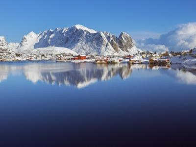 Fishing village of Reine and coastal mountains in the Lofoten Islands by Frank Krahmer