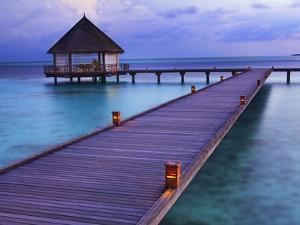 Pier at Island Hideaway at Dhonakulhi in Haa Alifu Atoll by Frank Krahmer