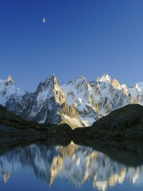 Aiguilles de Chamonix and and Mont Blanc reflected in Lac Blanc at sunset by Frank Lukasseck