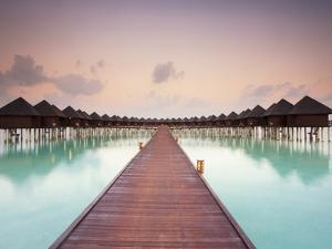 Boardwalk and Water Bungalows after Sunset by Frank Lukasseck