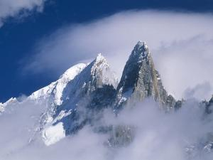 France, Alps, Mont Blanc Massif, Aiguille Verte, peak in clouds by Frank Lukasseck