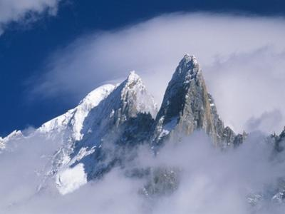 France, Alps, Mont Blanc Massif, Aiguille Verte, peak in clouds