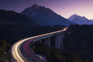 Light Trails on Mountain Pass by Frank Lukasseck