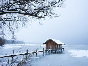 Snow covered pier and boat house at Lake Starnberg by Frank Lukasseck