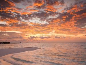 Sunrise over the Maldive Islands by Frank Lukasseck