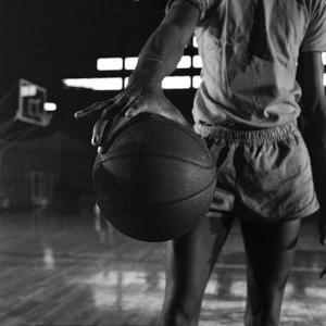 Basketball Held by Player Wilt Chamberlain, 1956 by Frank Scherschel