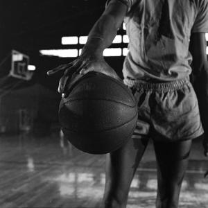 Basketball Held by Player Wilt Chamberlain, 1956 by Frank Scherschel