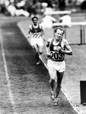 Distance Champion Emil Zatopek as He Set a New 10,000 Meter Record During the Olympic Games
