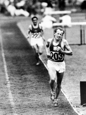 Distance Champion Emil Zatopek as He Set a New 10,000 Meter Record During the Olympic Games by Frank Scherschel