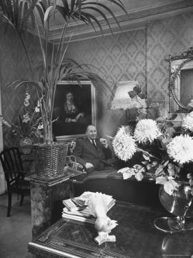 Dress Designer Christian Dior at Home in His Living Room by Frank Scherschel