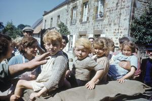 French Children in the Town of Avranches Sitting on Us Military Jeep, Normandy, France, 1944 by Frank Scherschel