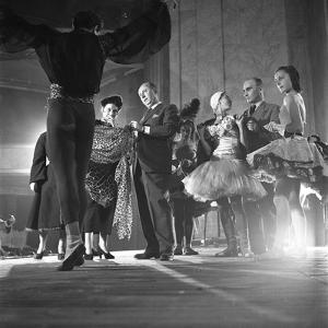 French Designer Christian Dior Adjusting a Leopard-Print Fabric on a Dancer, Paris, November 1947 by Frank Scherschel