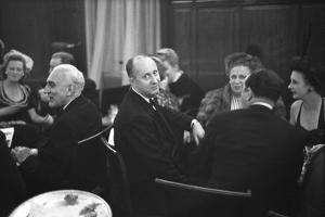 French Designer Christian Dior Drinking with Unidentified Others at a Bar, Paris, November 1947 by Frank Scherschel