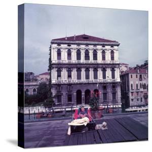 Heiress Peggy Guggenheim Sunbathing on Terrace of Venier Dei Leoni Palace on Grand Canal in Venice by Frank Scherschel
