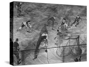 NY Rangers' Goal is Characteristic of Chicago Black Hawks Style of Attack in Ice Hockey Game by Frank Scherschel