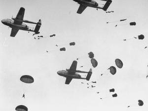 """Scores of Paratroopers Dropping from C-82 """"Flying Boxcar"""" and Landing on Level Ground by Frank Scherschel"""