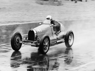 https://imgc.allpostersimages.com/img/posters/frank-wall-driving-a-bugatti-type-35b-1926_u-L-Q10M0U90.jpg?p=0