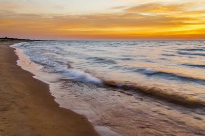 USA, Michigan, Paradise, Whitefish Bay Beach with Waves at Sunrise